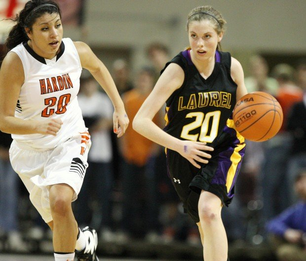 Allie McGrath of Laurel pushes the ball up the floor