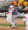 Billings Scarlets first baseman Max Tolstedt collides with Jace Waters