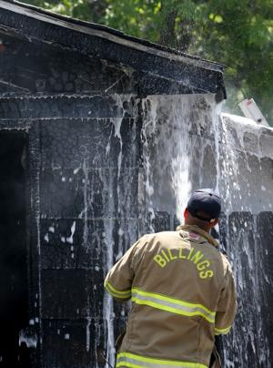 Billings firefighters extinguish a garage fire