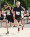 Runners battle at the finish