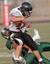 Central's George Smith, 20, and Ian Byorth, 8, tackle Frenchtown's David Anderson, 42