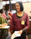 Nubia Allen receives a flag