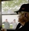 Bill Evans, of Casper, watches airmen salute