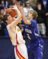 Kooper Kidgell steals a ball from Mitchell Hall