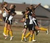 The Billings West soccer team celebrates Marta Prosinski's goal