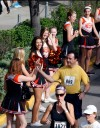 A runner high-fives cheerleaders