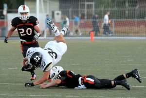 West's Zach Wolff tackled by Senior's Nathan Dick