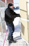 """""""Livin' Large"""" Larry Wilson exits a storage shed"""