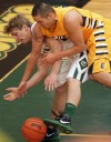 MSUB's David Arnold, 13, and Rocky's Derek Bartel, 5, battle for the ball i