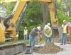 MDU workers dig up the gas line on Granite Avenue