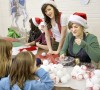 Youth Volunteer Corps helps at holiday carnival