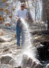 Homeowner Mike Pontarelli sprays down hot spots