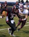 Zane Tunby chases down Tanner Oblender