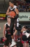Huntley Project's Michael Harris, 10, rebounds