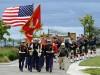 The U.S. Marine Corps Delta Company color guard leads a procession