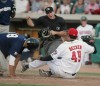 A home plate umpire calls Michael Garza of Helena out after being tagged by Mustangs pitcher Nolan Becker