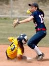 Stephanie Caron throws to first