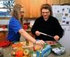 Lynn, right, and Ashley Olson prepare sack lunches