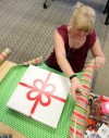 RiverStone employees wrap gifts for homeless children, clients in need