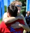 Daniel Weidner, right, and Anders Schilz embrace while competing