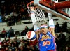 The Harlem Globetrotter's Hacksaw Hall dunks the ball