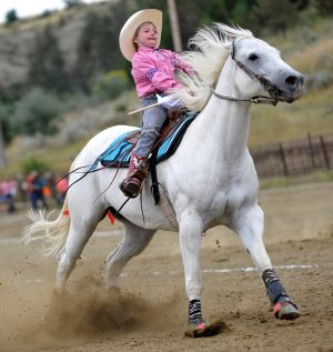 Rileigh Newkirk slows her horse