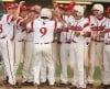 Max Tolstedt of the Billings Scarlets gets mobbed by teammates at home plate