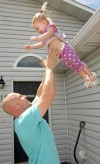 Nate Benfit plays with his daughter Harper