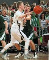 Stevensville's Jared Schultz, 23, looks to pass as Central's Blayne Sandau, 22, defends i