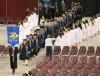 Graduates march in