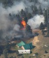 Homes threatened by the expanding Dahl fire
