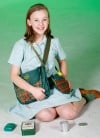 Sunny Satrom wears a Girl Scout camp uniform