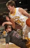 West's Jared Samuelson (32) heads for the basket