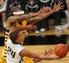 Rocky's Malachi Roberts, 24, puts up a shot as MSUB's Sam Johnson, 12, defends