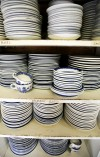 Plates and cups are stacked in the kitchen