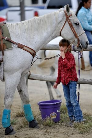 Madison Felchle waters her horse
