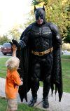 Cavan Wood, 2, gets a high-five from Batman