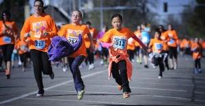 Record turnout for Montana Women's Run floods downtown with a sea of orange