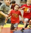 R.J. Lowdog runs in a circle around a wrestling mat