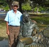 Cuban with John Lennon statue in park