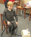 Alex Laas, 10, demonstrates his cystic fibrosis vest