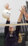 Miles City's Kadie Heinle bocks a spike