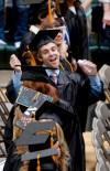 A graduate does a dance