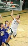 Billings Central's Daniel Meyer drives to basket
