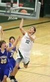 Billings Central's Daniel Meyer drives to basket