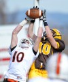 Cooper Kouwenhoven blocks a pass intended for Capital High wide receiver Brady Batista