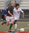 Senior's Colin Gregory, 17 and Skyview's Jett Lokken, 25,  battle for the ball