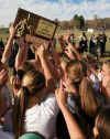 The Central girls soccer team hoists the trophy