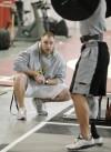 Strength coach Adam Husk watches over Koni Dole