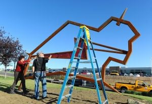 Bison sculpture installed near Billings airport to honor former director